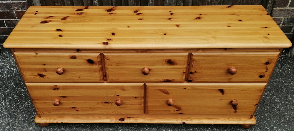 Low Honey Pine Chest of Five Drawers
